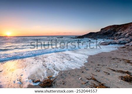 Sunset at Little Fistral Beach beneath the Towna Headland in Newquay, Cornwall - stock photo