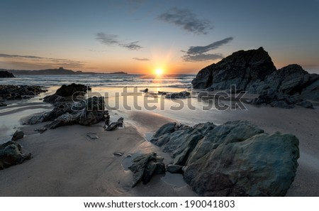 Sunset at Lusty Glaze beach at Newquay in Cornwall - stock photo