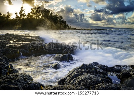 Sunset at ocean coast in Hilo, Hawaii, Big Island. - stock photo