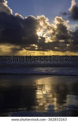 sunset at pacific beach - stock photo