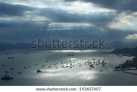Sunset at sea in Hong Kong - stock photo