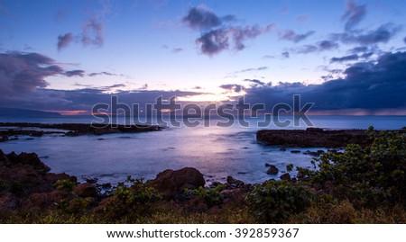 Sunset at Shark's Cove, North Shore, Oahu, HI - stock photo