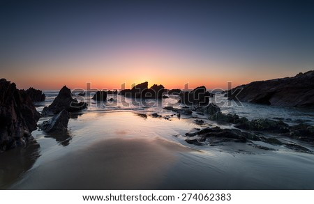 Sunset at Sharrow Point on Whitsand Bay in Cornwall - stock photo