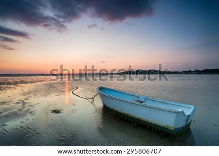 Sunset at Shore Road beach on the Sandbanks peninsular at Poole in Dorset - stock photo