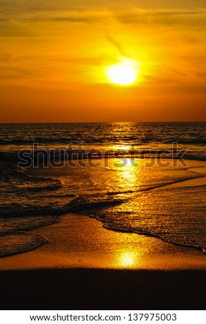 sunset at the beach - stock photo