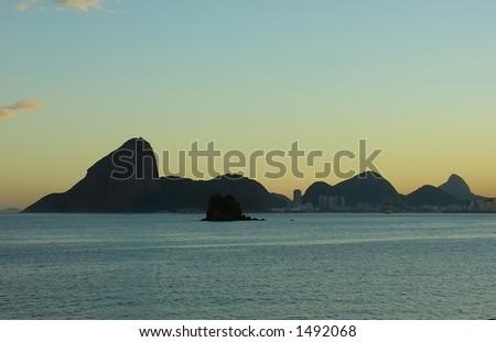 Sunset at the beach in niteroi, Rio de janeiro, Brazil - stock photo
