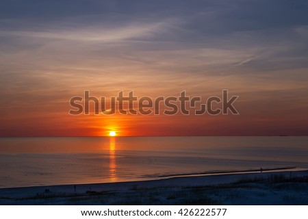 Sunset at the beach in Ventspils, Baltic Sea. Ventspils a city in the Courland region of Latvia. Latvia is one of the Baltic countries - stock photo