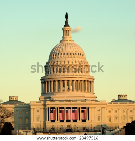 Sunset at the capitol building decorated with flags for the 2009 inauguration - stock photo