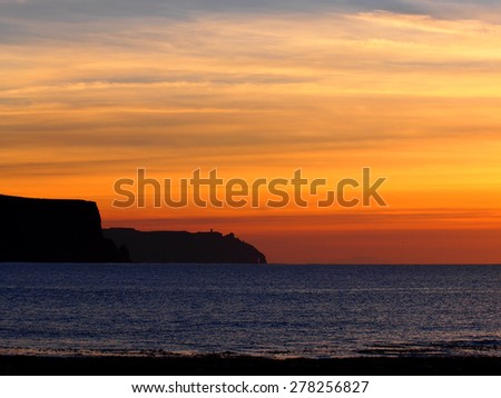 Sunset at the Cliffs of Moher, Ireland.  - stock photo