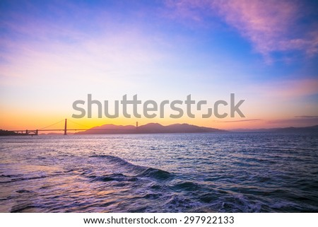 Sunset at the Famous Golden Gate Bridge, San Francisco, California, USA.  View from Crissy Field of Waves. - stock photo