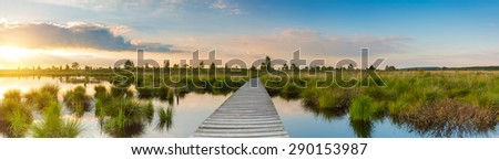 Sunset at the hautes fagnes (Hohes Venn) panorama with wooden bordwalk, belgium - stock photo