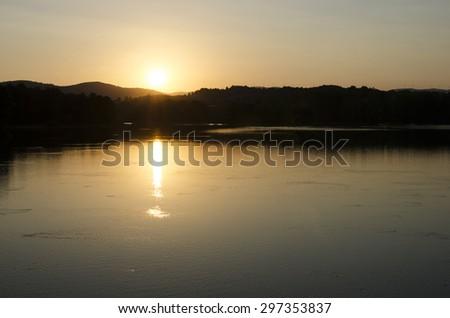 sunset at the lake  - stock photo