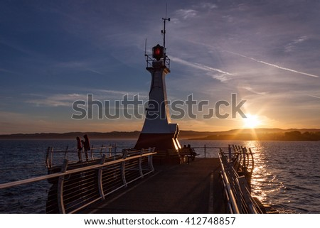Sunset at the Ogden Point breakwater in Victoria, British Columbia - stock photo
