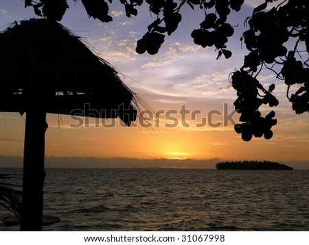 Sunset at the Pacific Island - stock photo