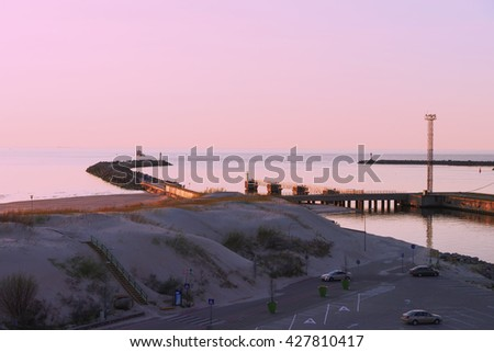 Sunset at the pier on the Baltic Sea in Ventspils. Ventspils a city in the Courland region of Latvia. Latvia is one of the Baltic countries - stock photo