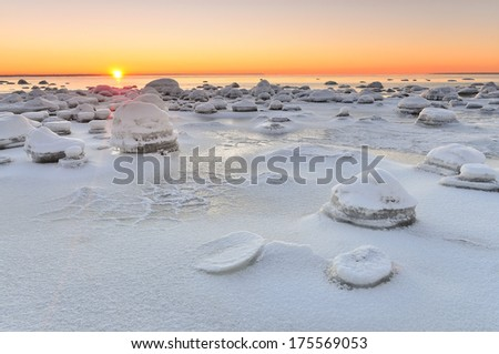 Sunset at the wintry sea - stock photo