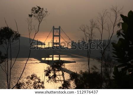 Sunset at Tsing Ma Bridge, Hong Kong - stock photo