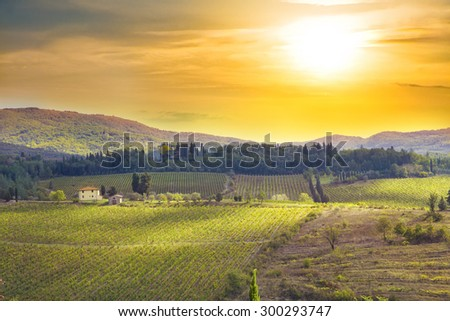 Sunset at Tuscany meadows, italian rural landscape near Florence - stock photo