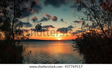 Sunset at Vaya lake, Burgas city, Bulgaria - stock photo