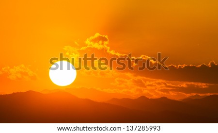 Sunset background over the mountain - stock photo