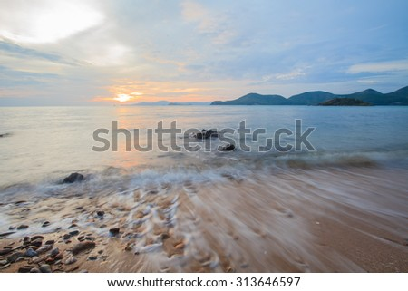 Sunset beach,Mist sea. - stock photo