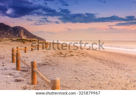 Sunset beach near Almeria. Cabo de Gata Nijar Natural Park, Spain. Andalusia - stock photo