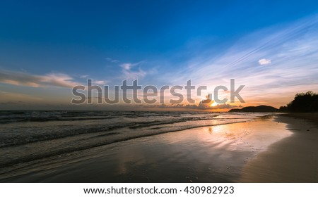 Sunset. Beautiful sunset at east part of Thailand. Gold sea sunset. Sea sunset. Sea sunset background. Amazing sea sunset Sunset sea picture. Sunset sea waves. Summer sunset. - stock photo