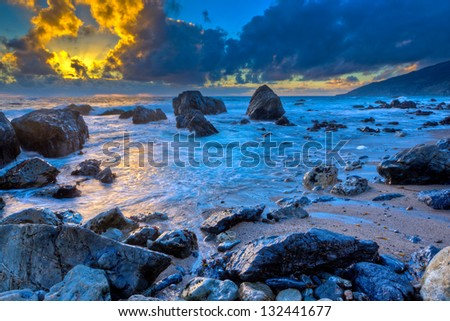 Sunset behind storm clouds, Big Sur, California - stock photo