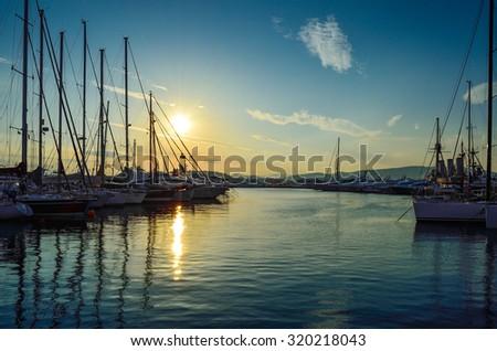 Sunset behind the yachts at marina flisvos in Athens - Greece - stock photo