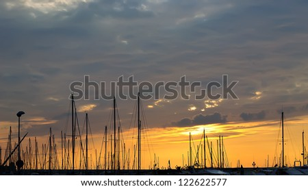 sunset by Alghero sea - stock photo