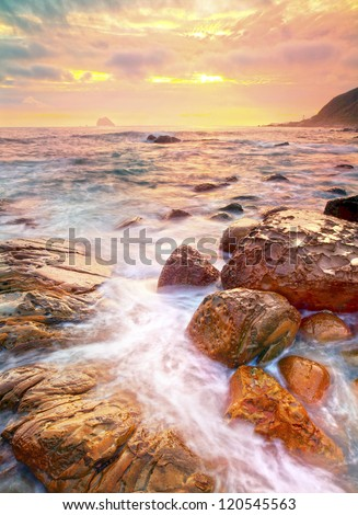Sunset by the beach - stock photo