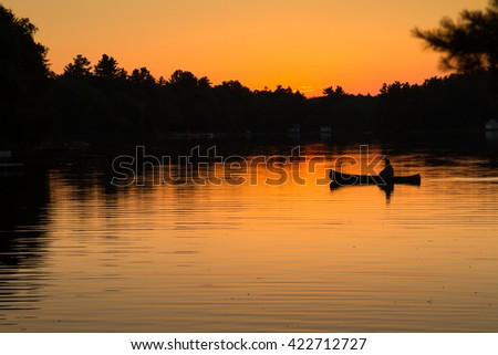 Sunset Canoe - stock photo