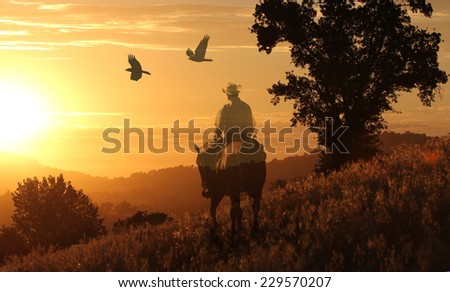 Sunset cowboy off the trail. - stock photo