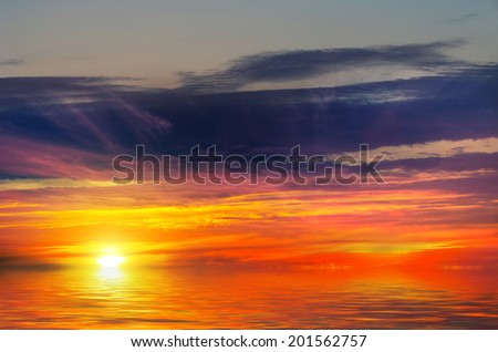 Sunset-fire against the sea. Flame-haired beauty - stock photo