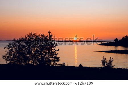 Sunset fishing in the White sea - stock photo
