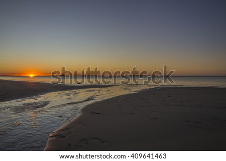 SUNSET, FRASER ISLAND, QUEENSLAND, AUSTRALIA: Great sunset at the beach in Queensland. - stock photo