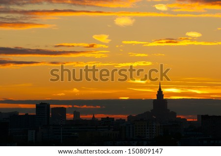 Sunset Glow and  Silhouetted skyline of Moscow-2 It is the stunning sunset glow of Moscow. The Silhouette of Moscow skyline and skyscrapers are so beautiful. Triumph Palace is on the right side. - stock photo