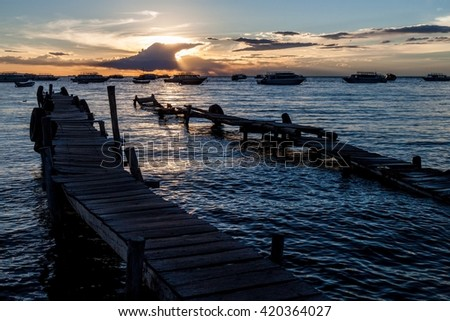Sunset in a harbor  of Copacabana town on Titicaca lake, Bolivia - stock photo