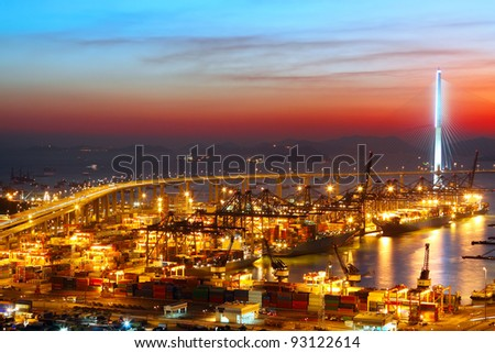 sunset in cargo container terminal - stock photo