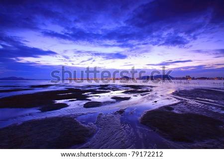 Sunset in Hong Kong along the coast at dusk - stock photo