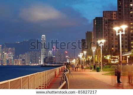 sunset in hongkong Waterfront Promenade - stock photo