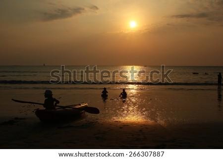 Sunset in Kammara beach and sailboat silhouette. Phuket, Thailand - stock photo