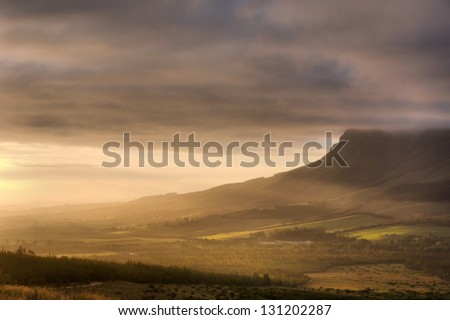Sunset in mountains. Shot in Hottentots-Holland Mountains nature reserve, near Somerset West/Cape Town, Western Cape, South Africa. - stock photo