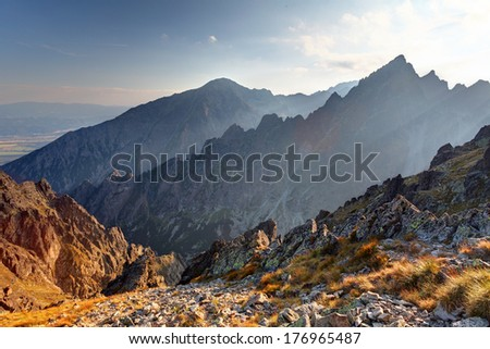 Sunset in mountains view from Lomnicke sedlo in High Tatras, Slovakia - stock photo