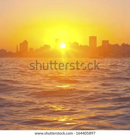 Sunset in Mumbai, India  - stock photo