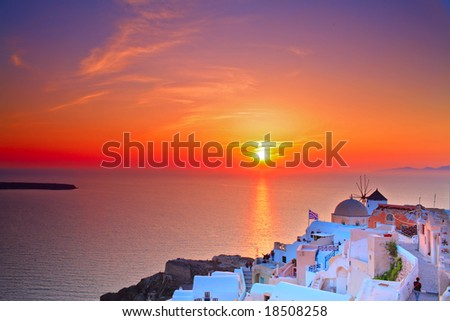 Sunset in Oia village on Santorini island, Greece - stock photo