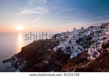 Sunset in Oia village, Santorini, Greece - stock photo