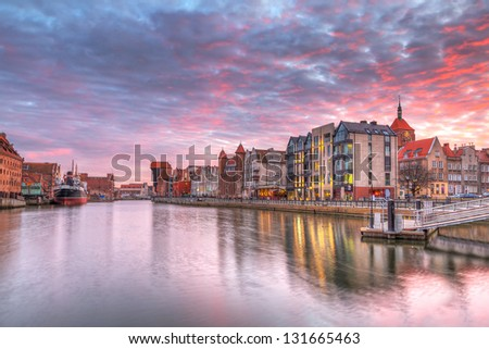 Sunset in old town of Gdansk at Motlawa river, Poland - stock photo