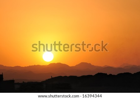 sunset in the Arabian Desert - stock photo
