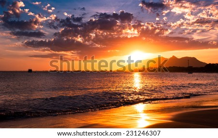 Sunset in the Beach with Mountains in the Horizon, Rio das Ostras, Brazil - stock photo
